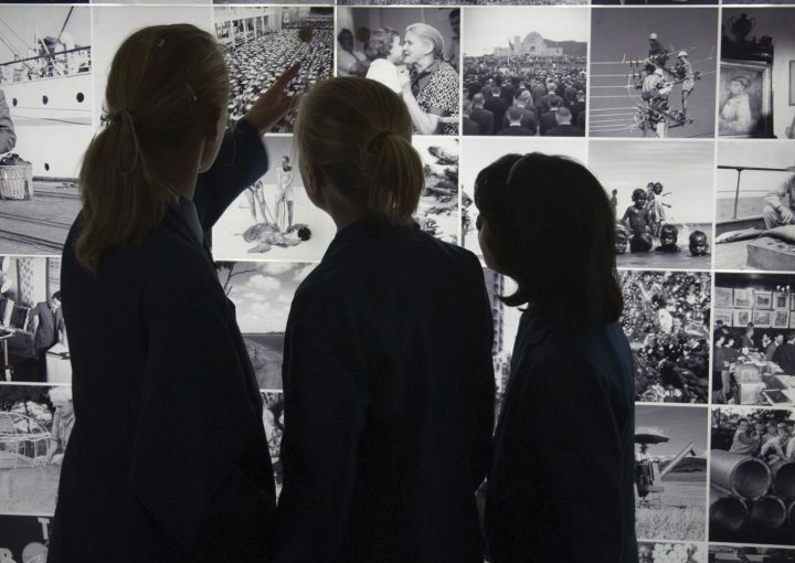 Three people looking at display at the National Archives