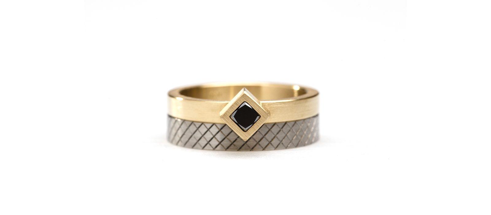 Phoebe Porter, Angled Cubist and Cross Cut ring, 2018. 750 yellow gold, black diamond, titanium. Photo: Andrew Sikorski