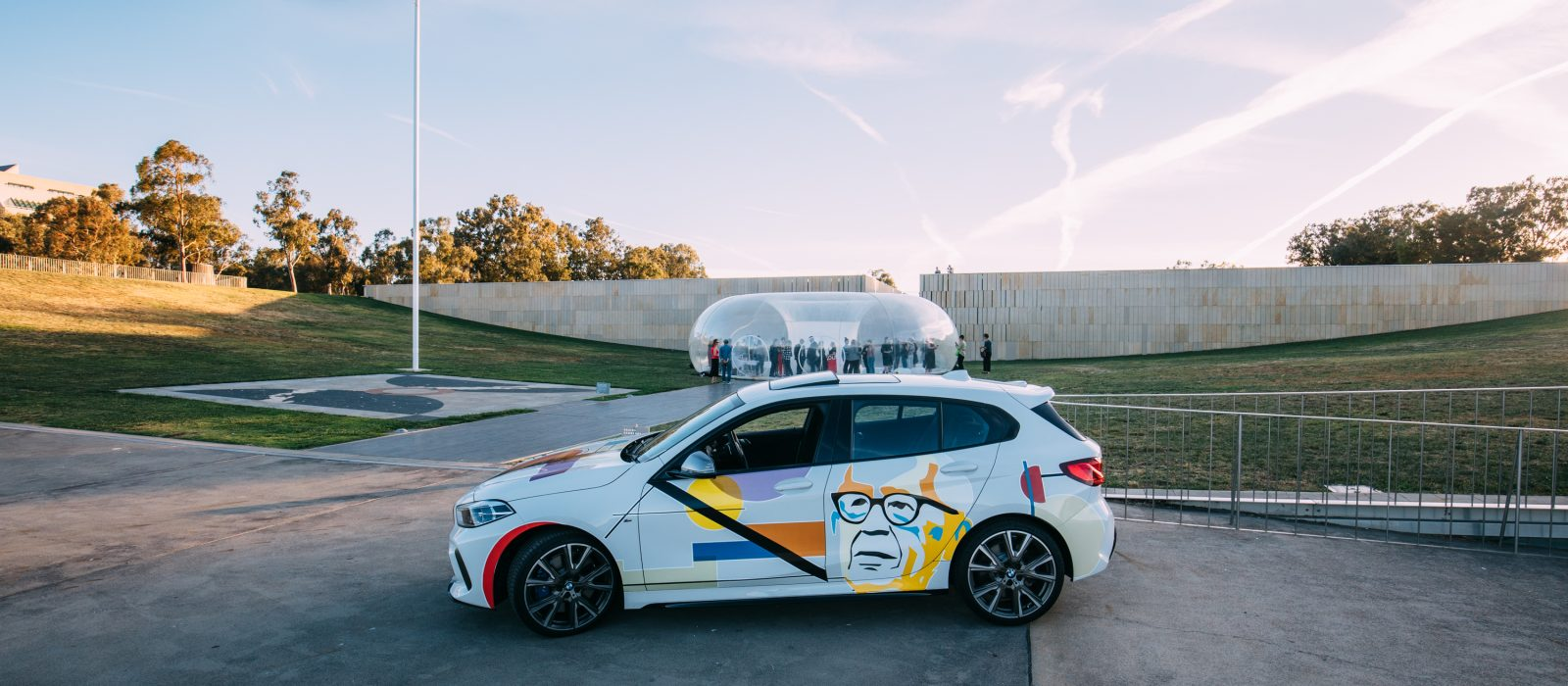 2019 car wrap winning design by University of Canberra student Kye Jones on display during the 2019 festival. BMW Series 1 courtesy of Rolfe Classic BMW, car wrap by ROJO Customs, installation MEDUSA by Plastique Fantastique. Photo: 5 Foot Photography