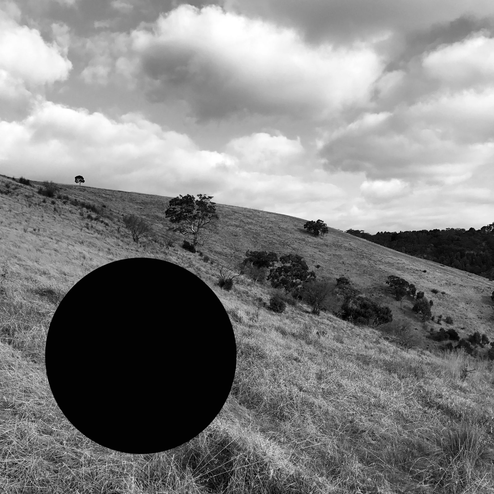 James Tylor, Vanished From an Untouched Landscape 8, 2018, Inkjet print on hahnemuhle paper with hole removed to a black velvet void, 50x50cm.